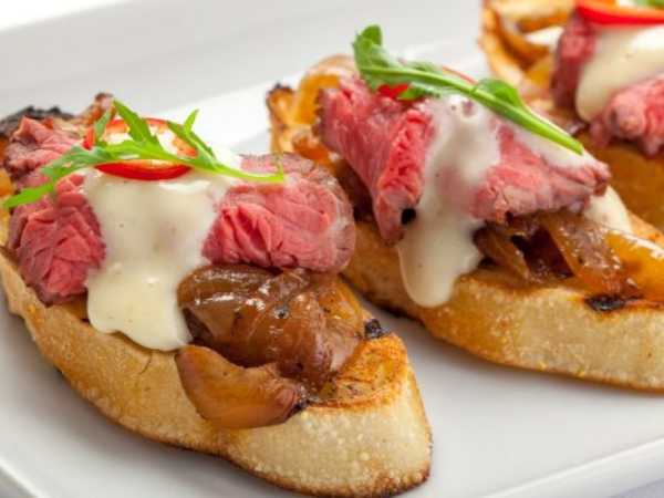 Tenderloin Crostini With Onion Confit And Dijon Horseradish